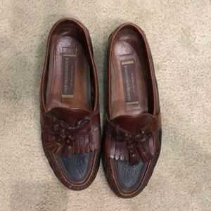 Black and brown loafers with tassels